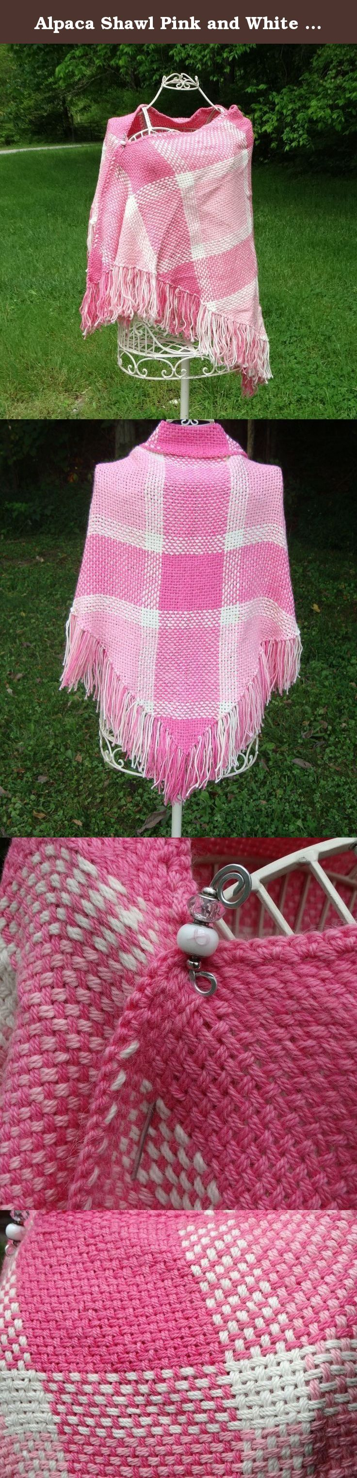 Alpaca Shawl Pink and White Handwoven. This bright pink and white shawl was hand woven using a double strand of 100% alpaca yarn. The Pinks are from a Limited Edition Yarn called Pinks with Purpose. A portion of the sales of this yarn was donated to Cancer Research. The white yarn is from our own farm. All the yarn was spun by the same mill and then woven on my triangle loom. The design is my own. This shawl is a one of a kind and unique item. It's warm and soft and very PINK !!! Every…