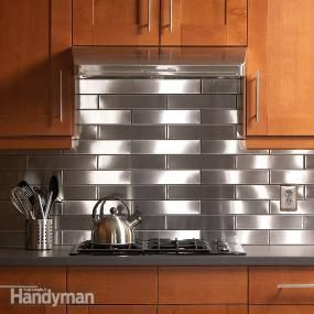 Stainless Steel Kitchen Backsplash  i've seen the stainless steel and bronze tiles at the depot - low cost for backsplash area and nice clean look