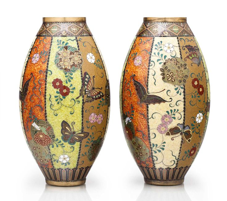 A pair of cloisonné enamel jars  Meiji period (late 19th century), attributed to the workshop of Namikawa Yasuyuki (1845-1927) Each jar of bulbous form decorated in polychrome enamels and gold and silver wires with panels of beige, brown, speckled green and orange designed with scattered roundels of flowers and butterflies, the shoulder with a floret pattern and the foot with a band of stylized lotus petals