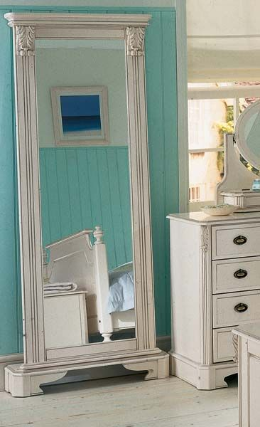 take a full length mirror and add reeded columns with unique corbels and distinctive plinths with