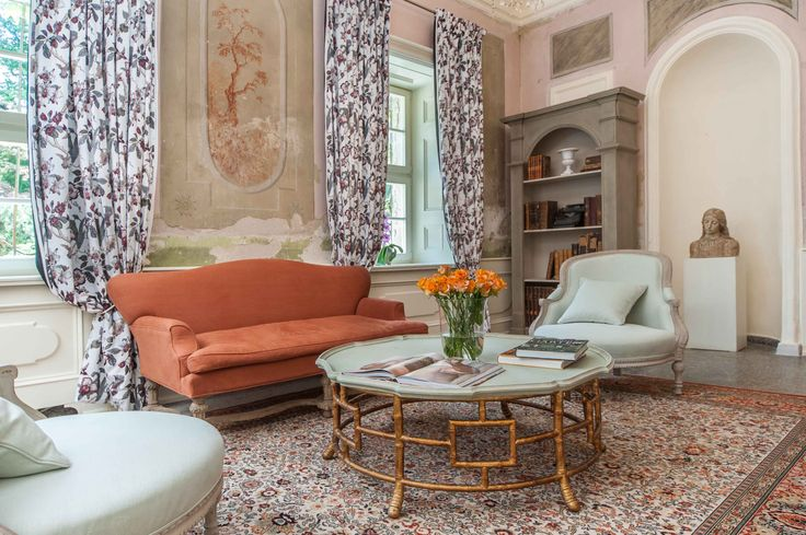 Orangery. Beautiful coffee table with mint-colored matt top and curved legs connected geometrical pattern. Price: 6 480 PLN.