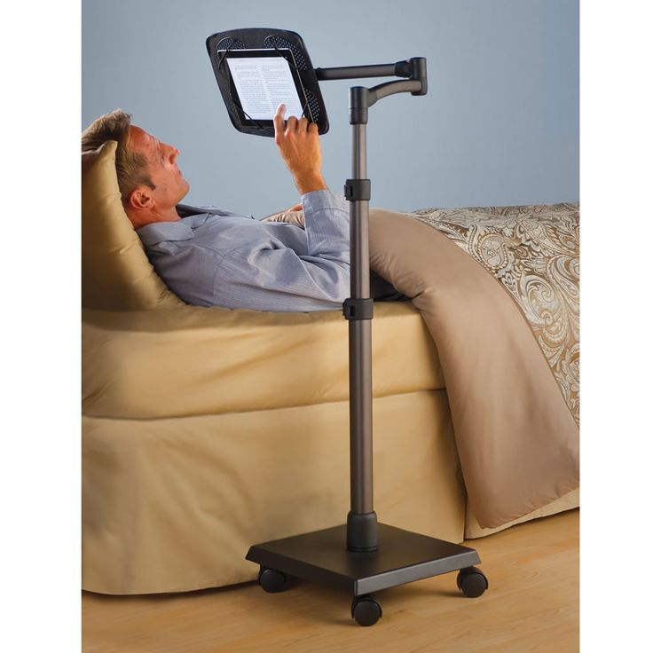 "The Rolling Bedside iPad Stand. ($199.95) height-adjustable, articulating swing arm lets you place your device at the ideal eye level, distance, & angle (even upside down) while you lie supine, recline, or sit upright. The swing arm can be raised or lowered from 30""-56"" H with sturdy clip locks. Folds out of the way. Secures any iPad, tablet, or e-reader up to 8 1/2"" x 11"" (even while in its case) via four elastic bands, rotates easily for portrait or landscape. Swivels 360º."