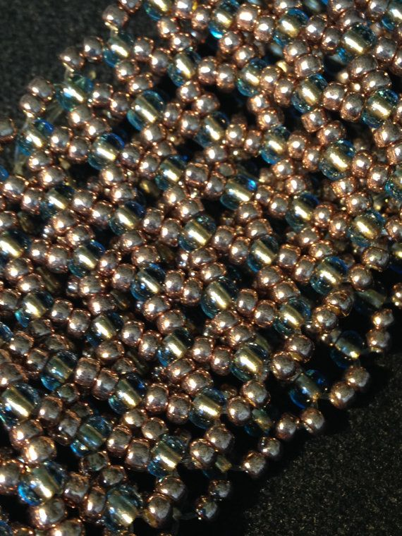 Copper and green/blue colour beaded bracelet