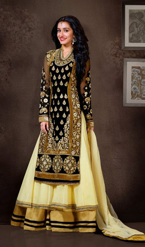 Bollywood Diva Shraddha Kapoor Long Anarkali Churidar Suit Epitomize sophistication like Bollywood diva Shraddha Kapoor adorned in this Black and cream shade, velvet and faux georgette layered long Anarkali churidar suit. Upper layer of the kameez features pita and resham embroidered foliage patterns and motifs ornamented with stick on crystals and motis. Contrasting hemline patches enchain the charm of the attire.  #LongAnarkaliChuridarSuit #GeorgetteAnarkaliSuits