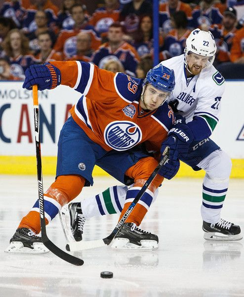Leon Draisaitl Photos Photos - Leon Draisaitl #29 of the Edmonton Oilers battles with Daniel Sedin #22 of the Vancouver Canucks on April 6, 2016 at Rexall Place in Edmonton, Alberta, Canada. The game is the final game the Oilers will play at Rexall Place before moving to Rogers Place next season. - Vancouver Canucks v Edmonton Oilers