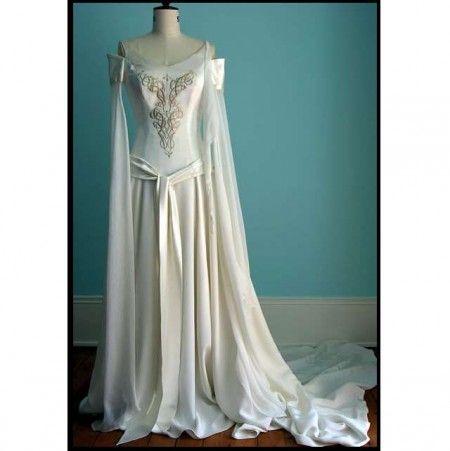 Celtic Wedding Gown, white silk embroidered with gold thread, sheer, floor-length sleeves with top cuff, and straps. Silk knotted sash, dropped waist, long, gathered skirt.