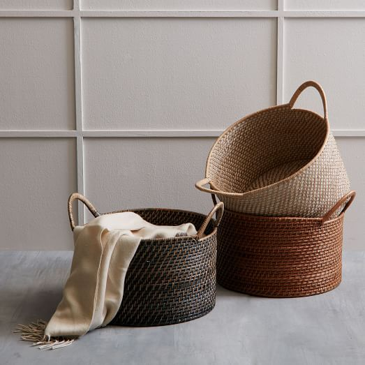 Sturdy storage for magazines, media and more, the durable frames of our Modern Weave Handled Baskets are covered in tightly handwoven rattan peel and stained to highlight its rich texture.