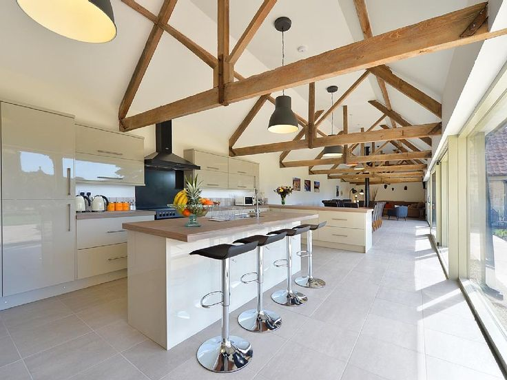 - Large open plan kitchen overlooking the dining and living area