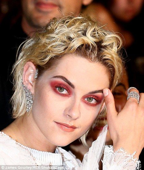 Seeing red! Kristen Stewart turns heads with dramatic eye makeup and thigh-grazing mini dress as she hits the Cannes Film Festival premiere of her new film Personal Shopper | Daily Mail Online