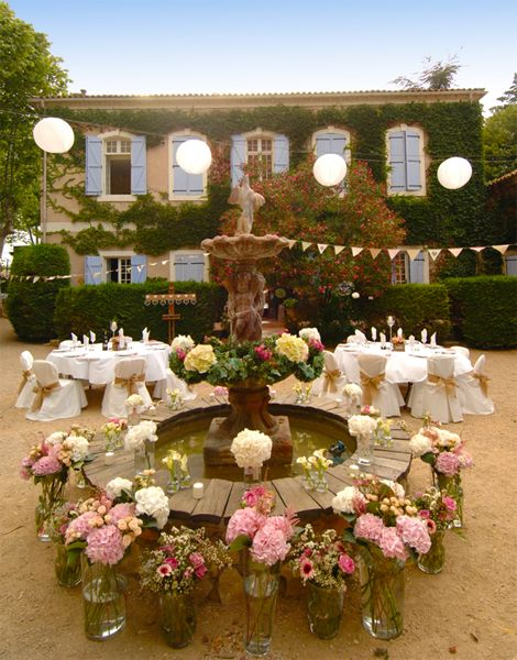 Ancient inner courtyard at Chateau du Puits es Pratx in the South of France. We hold our wedding banquets within our ancient courtyard with candelabra hanging from the trees, candles and hanging lanterns, it is very magical. Photography Tim Hazael.