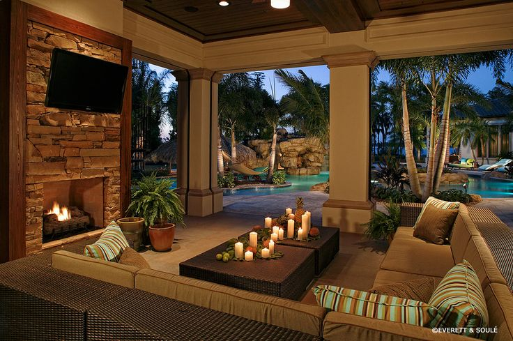 outdoor living patio and pool florida room designs Pool Tropical with outdoor fireplace
