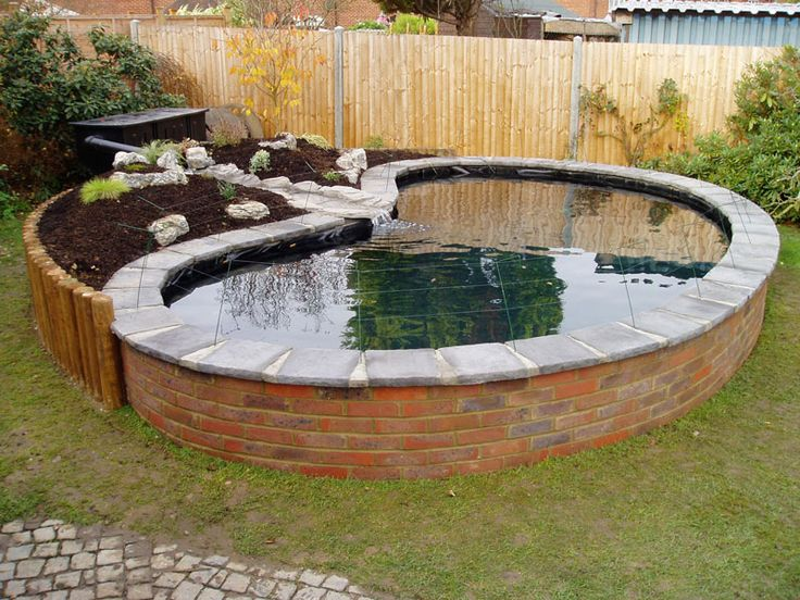 Hide above ground pond stone koi fish stock tank for Pond yard design