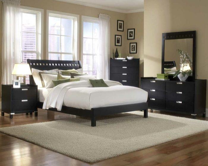 eine weiße Matratze und schwarzes Untergestell, schwarze Regale, weißer Teppich, Laminat Boden, moderne Zimmer