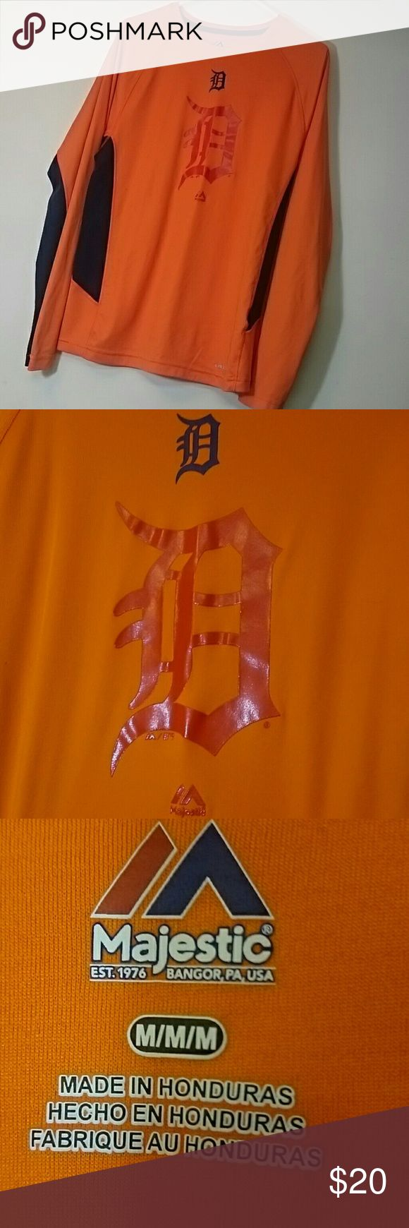 Detroit Tigers dri-fit Majestic long sleeved dri-fit shirt. Detroit Tigers. Bright orange and navy, very comfortable. Only worn a handful of times. Small snag along the side (shown in pictures), no stains. Majestic Shirts Tees - Long Sleeve