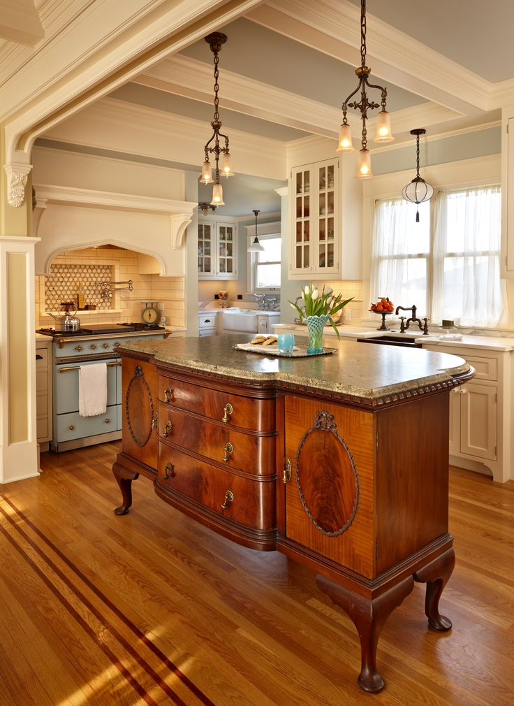 The #kitchen island uses an antique sideboard with a granite countertop  placed on top!