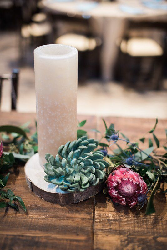 Simple wedding centerpiece idea - candle on tree slice base with succulents {Copper & Birch}