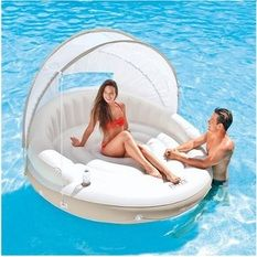 A seriously cool white lilo for two! http://poolholiday.com/pool-fun/the-best-lilos/