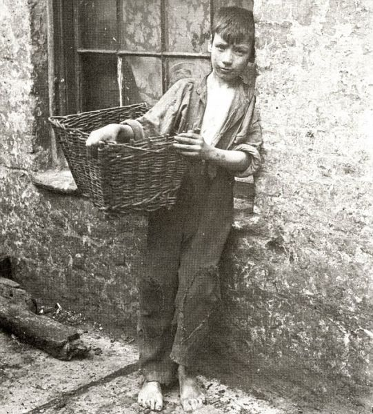 100yr old pic of a poor child in the east end of London: I'd love to think his descendants are rolling in it now