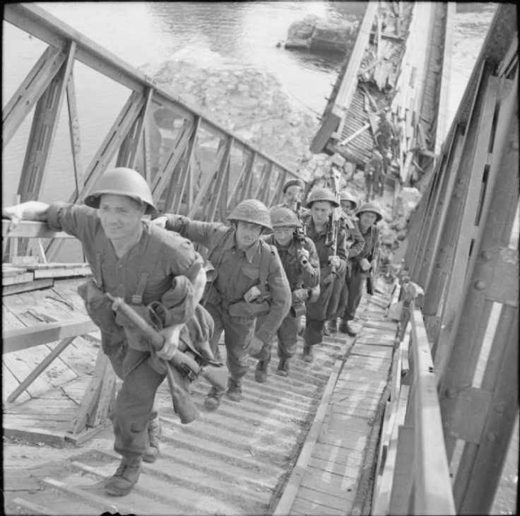 Infantry cross the River Seine across the wrecked road bridge at Vernon, 27 August 1944. © IWM (BU 199)Crossing the Seine and the advance to the Siegfried Line 24 August – December 1944: British troops crossing a temporary bridge over the River Seine at Vernon as General Montgomery's 21st Army Group launched a drive which in a week covered 200 miles to reach the Scheldt River in Belgium.