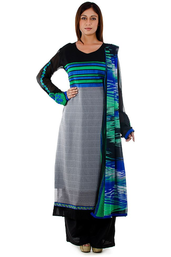 This is a black & grey colored straight cut suit made of georgette. It has a round neck, and the yoke is decorated with green and blue embroidered stripes. The ghera of the kurta has a digital printed pattern. It has black sleeves with green & blue embroidered floral patches. The suit comes with matching pants and dupatta