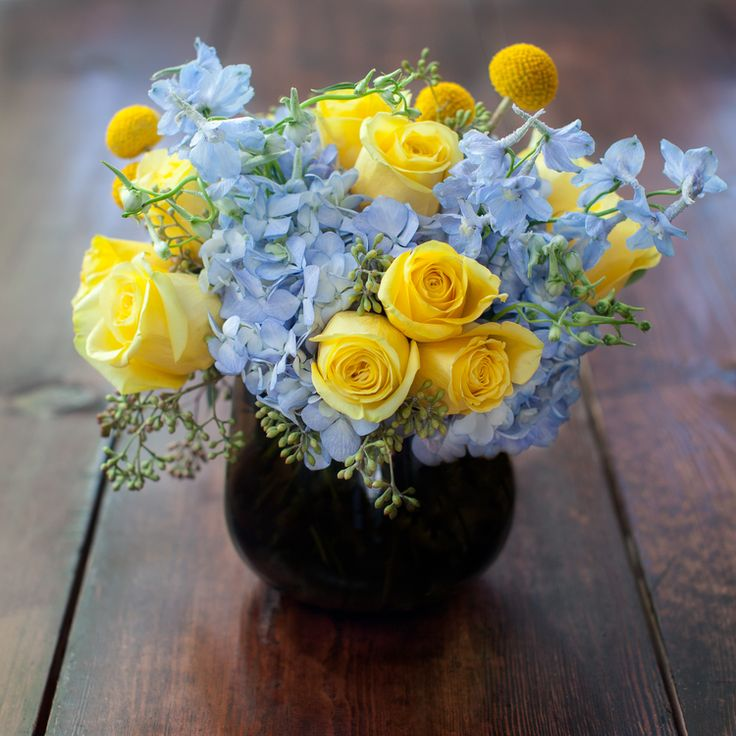 Warm Yellows And Cool Blues Come Together To Form A Classic Color Combination In This Arrangement With Roses Fun Craspedia Soft Blue Delphium