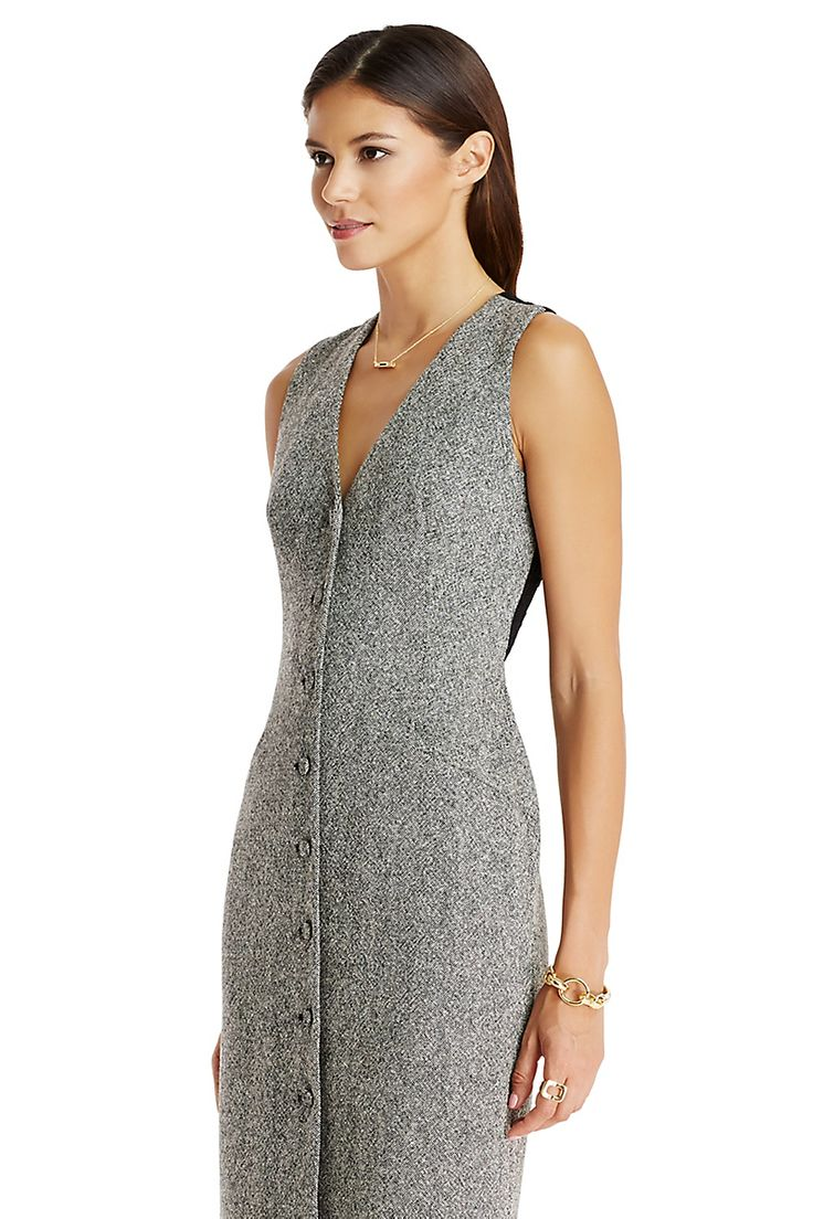 A traditional menswear piece is updated as a lace-accented, curve-hugging dress with confidence and attitude. Features front darts, faux pockets, a button up front, a lace back and a traditional back vest belt. Not sold with blouse. Falls to mid-thigh. Fits true to size.