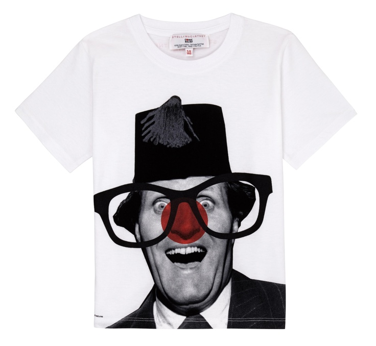 A white T-shirt featuring a striking black and white photograph of legendary British comedian Tommy Cooper, with the addition of a red nose and glasses. Designed by Stella McCartney exclusively for Red Nose Day. With at least £5 going to Comic Relief, helping to change lives across the UK and Africa, t-shirt is £9.99.  100% organic Fairtrade certified cotton. Wash at 40.