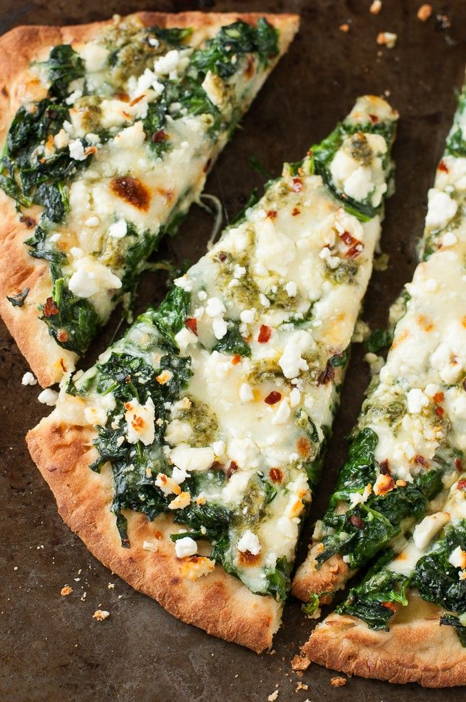 Aiming to eat more veggies? This Three Cheese Pesto Spinach Flatbread Pizza packs an entire box of spinach into one glorious single-serving pizza! Yum!