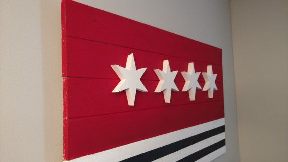 Show some Chicago pride with this wood display of Chicagos city flag in the Blackhawks colors! The flag is painted to match the Chicago Blackhawks famous striped jerseys and the stars added to give it a one of kind and unique look of the Chicago city flag. The stars are cut out and attached to give it a 3D look. Made from 100% pine, each flag is custom made and hand painted, making it a one of kind creation. Each flag can be hung by the wire mount attached to the back. Sizes available: 26...