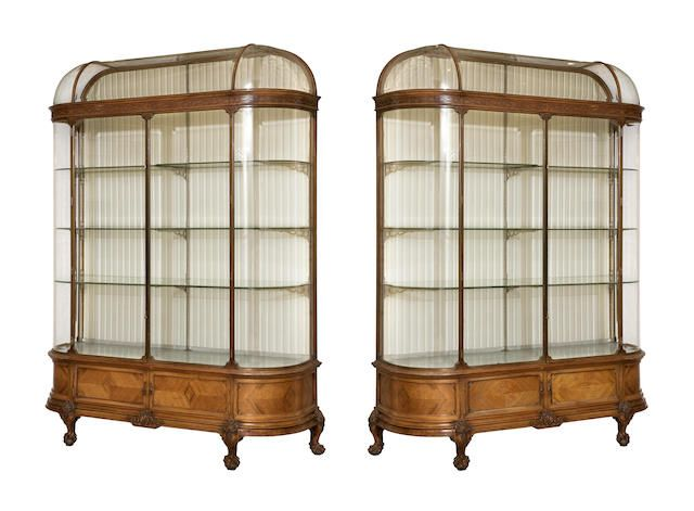 A pair of walnut, bronze and bevelled glass showcases, by F. Sage & Company Ltd., first quarter 20th century,