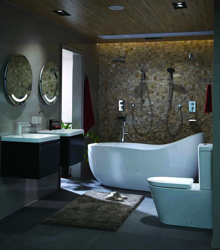 A minimalism bathroom with freestanding bathtub, square toilet, and wall hung vanities