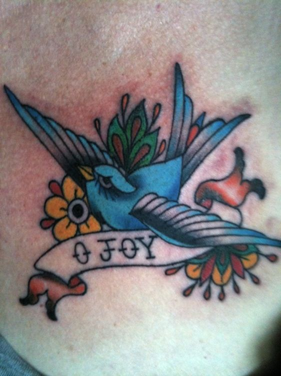 First tattoo, bluebird of happiness, by Glennie at Pearl Harbor Gift Shop, Toronto