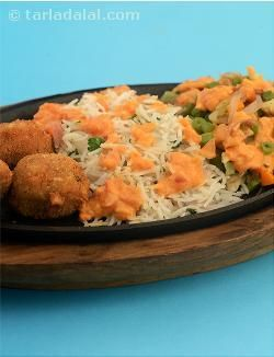 Continental Sizzler, sumptuous cheese corn balls served with buttered parsley rice, glazed vegetables topped with a red wine flavoured tomato sauce. You can serve pasta instead of the rice if you prefer.
