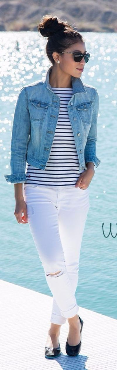 White jeans pairs with a black and white striped shirt, a jean jacket, and black flats