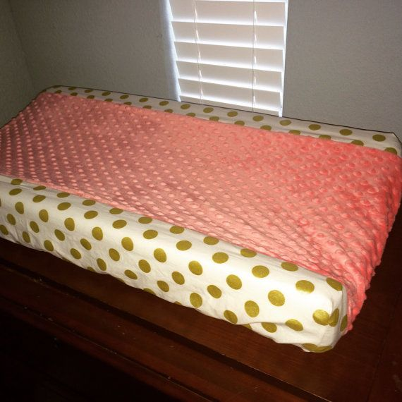 White with gold dots Changing Pad Cover with Coral minky dot fabric down the middle. All changing pad covers will fit any standard changing pad