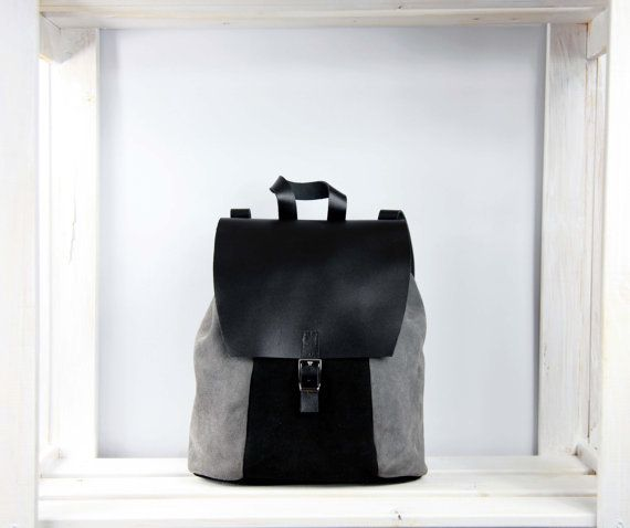 Rucksack made of genuine leather  Closes on the button hidden under the buckle  It has got regulated straps   Size: 25cm x 26cm x 17cm  It can be also made to order in size of 13 laptop   All products are handmade in our manufacture in Poland  Best material and quality