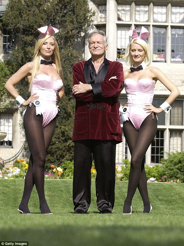 Living nightmare: Holly Madison (right) poses with fellow bunny Sheila Levell and Hugh Hefner at the Playboy Mansion May 6, 2003 in Holmby Hills, California