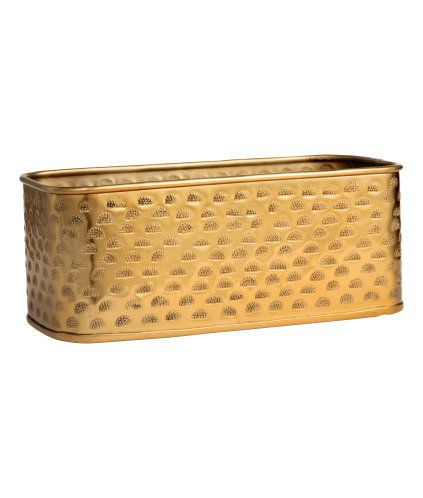 Gold-colored. Rectangular storage basket in metal with an embossed pattern. Size 4 1/4 x 4 3/4 x 9 3/4 in.