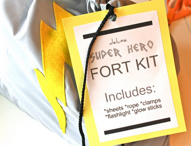 The super hero fort kit comes with Sheets, ropes, flash light, clamps, clothes pins, & suction cups all inside a drawstring lightening bolt bag. What a great gift idea for the children in your life.
