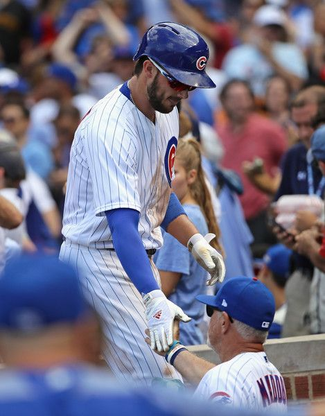 Joe Maddon Photos Photos - Kris Bryant #17 of the Chicago Cubs is congratulated by manager Joe Maddon #70 after hitting a solo home run in the 6th inning against the Pittsburgh Pirates at Wrigley Field on July 7, 2017 in Chicago, Illinois. - Pittsburgh Pirates v Chicago Cubs
