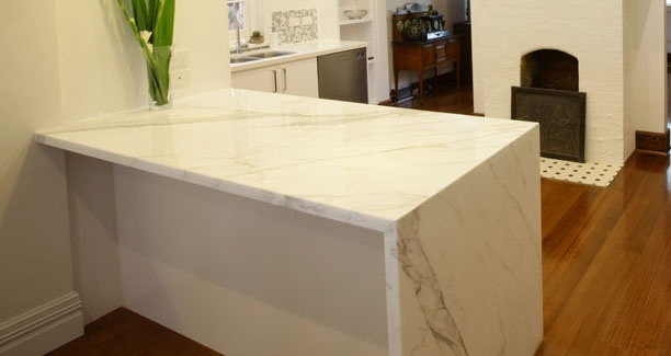 Marble waterfall benchtop with breakfast bar in kitchen renovation