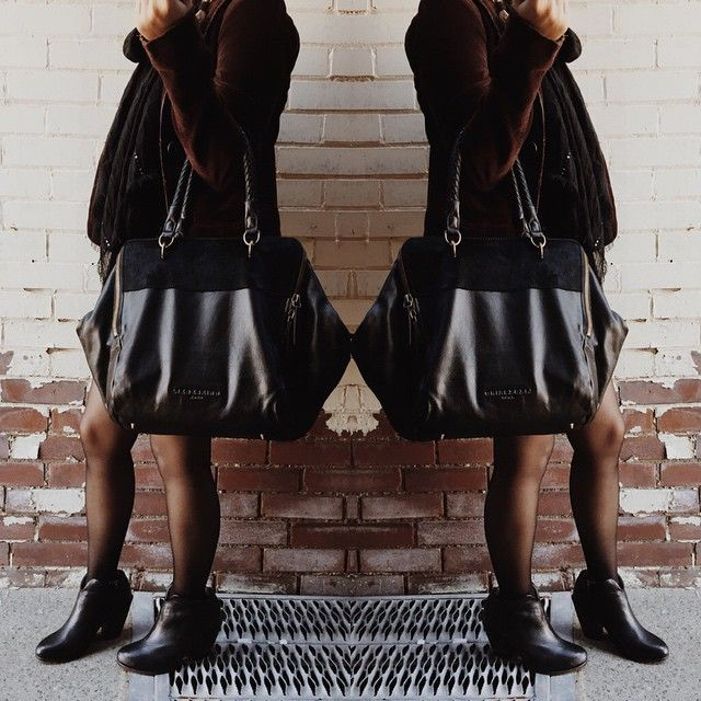 Weekender size purse in leather, with a fur top in a geometric hexagonal shape