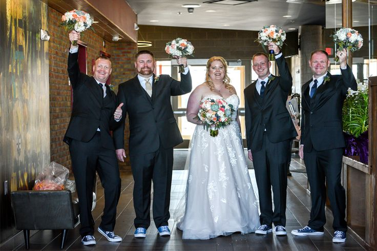 Groomsmen with bridesmaid's bouquets