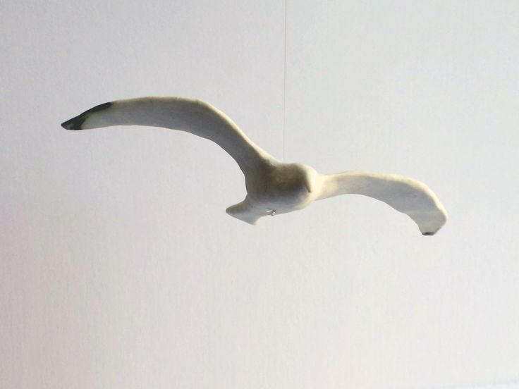 Ceramic seagull by Belinda Ormond in KIN on Kloof, Cape Town, for a window display by MOKO and Soil for Life to raise funds for Soil for Life's township gardens initiative. kinshop.co.za - growing local art & design