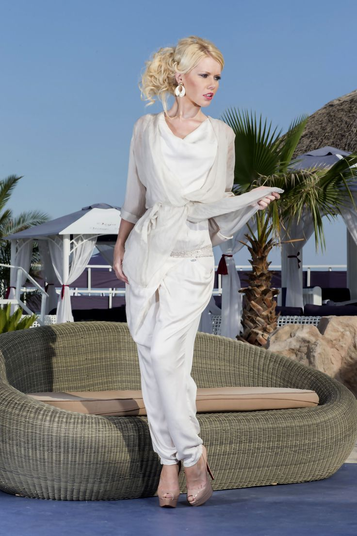 Angelo features two ultra feminine pieces from Vero Milano: a beige jumpsuit and matching beige silk shirt with transparent sleeves and a delicate drawstring waist. Soft and subtle summer style.