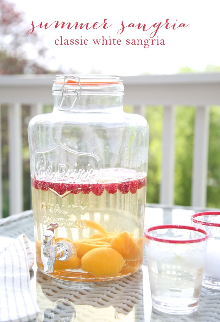 Easy classic white sangria recipe - serve drinks outdoors in a dispenser to eliminate the risk of bugs!
