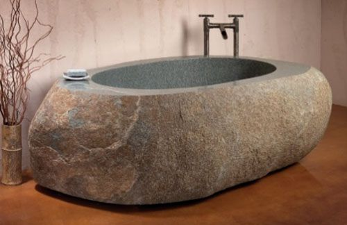 a bathtub carved from one solid boulder.