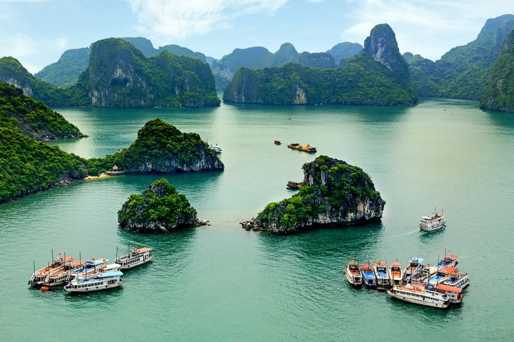 "Hạ Long Bay, Vietnam; Also known as ""Descending Dragon Bay,"" Hạ Long is a UNESCO World Heritage Site and popular tourist destination in Quảng Ninh, Vietnam. This natural wonder features turquoise waters, limestone karts, and isles of all shapes and sizes."