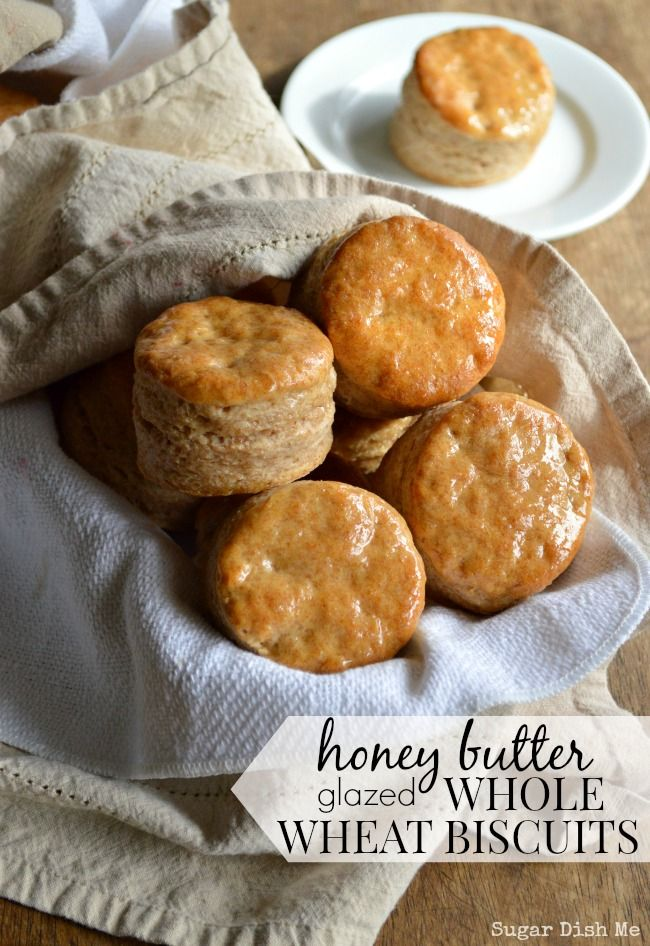 Honey Butter Glazed Whole Wheat Biscuits -- a recipe that is awesome for breakfast, lunch, and dinner! These biscuits are super easy and turn out every time.