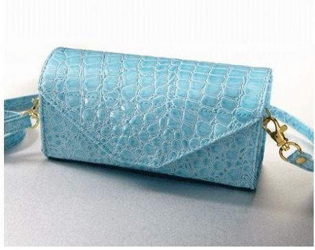 Are you looking for a purse that is not only stylish but comes with an affordable price tag?  The Sky Blue Croc Coupon Cubby purse is the perfect mix of trendy and affordable. This organizing purse...